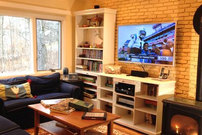 """With over 200 channels, and a 60"""" 3D HD TV, our cozy living room is a delight"""