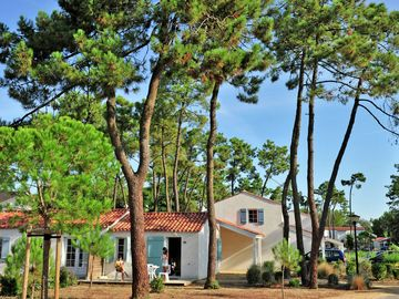 A holiday home surrounded by woods and just 700 metres from Conches Beach