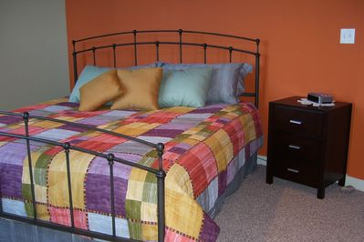 Master suite, wrought iron king bed