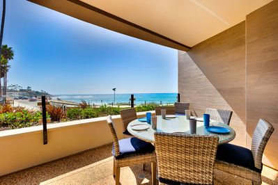 Dine al fresco any time of day and enjoy this serene ocean view.
