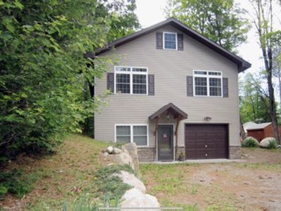 Photo for Beautiful Two story camp with Lake access, Full bar and Pellet fire place