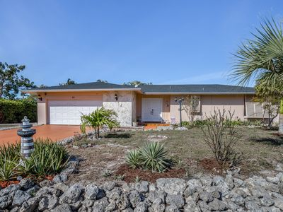 Photo for Lovely  family-friendly canal front home with private pool, neary the beach!