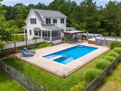 Photo for Upscale waterfront cottage with a pool and hot tub feet from the back door.