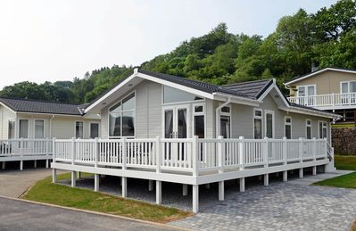 Photo for Luxury Lodge, Peaceful Woodland Location, Walk to Beach, Parking