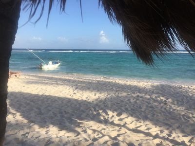 Relax on the beach under a palapa or palm tree.