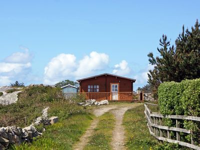Photo for Cedar cabin with timber decking, in quiet secluded setting about 500m from sandy beach, small…