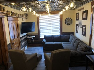 """The Detroit Room with a 55"""" TV equipped with Original Nintendo and Dish"""