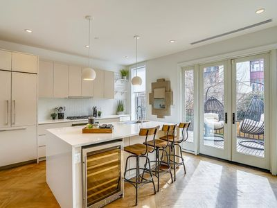 Photo for Charming and Trendy Brownstone near Train