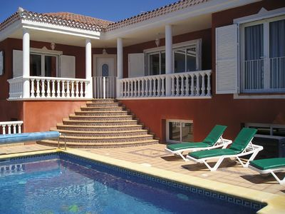Photo for Executive 3 bedroom private villa with heated pool, games room, wi fi & Air/Con