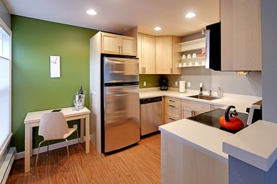 All new fully stocked kitchen with stainless steel appliances