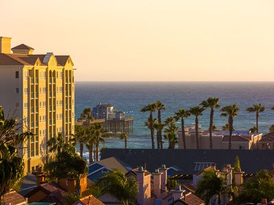 Photo for 25% OFF OCT/NOV - Beach Condo w/ Roof Top Deck, Ocean Views + Walk to Water