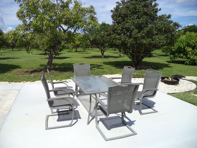 large patio area out back with fire pit and cooking grate