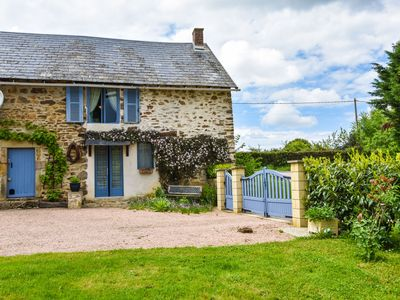 Photo for Charming typical Auvergne cottage with large garden and view of the countryside.