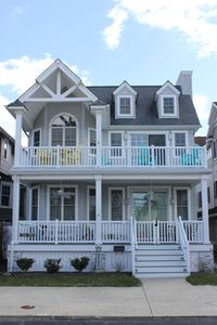 Second floor beauty !  Enjoy your summer evenings on this welcoming front porch!