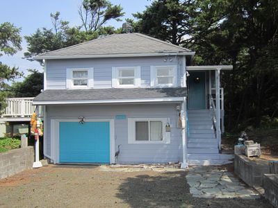 Photo for Charming beach bungalow with beach access across the street.