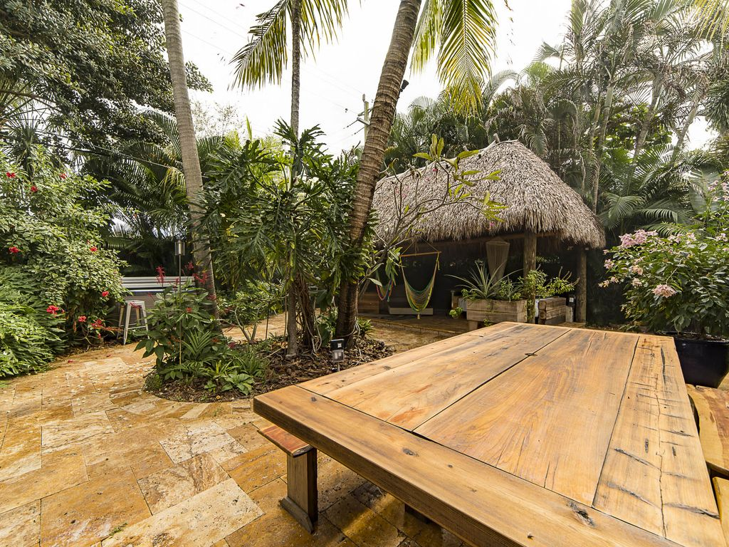 """Welcome to the  """"Hidden Oasis"""" 3 bedrooms 2.5 Bathroom Tropical Pool Home!!!"""