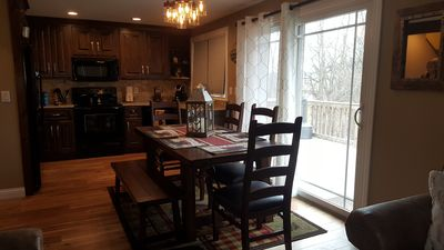 Dining Room, Table Seats 6, New Knotty Alder Kitchen Cabinets.
