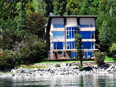 Photo for House with lake coast on the beach. Great view of Nahuel Huapi. Bariloche