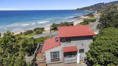 Photo for The Surf Shack - Relax on the deck while enjoying the stunning view