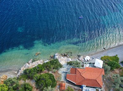 Aerial shot of the villa and beach below , secluded and private ,not overlooked