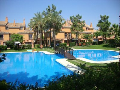 Photo for Luxury 3-bedroom house next to Islantilla Golf Club,air-con,internet sandy beach