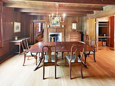 Formal Dining Room  - A formal dining space offers seating for 8 next to a flickering fireplace.
