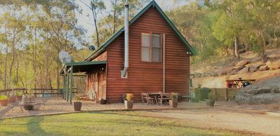 Our cabin with several outdoor seating options
