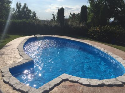 Early morning sun shimmering on pool