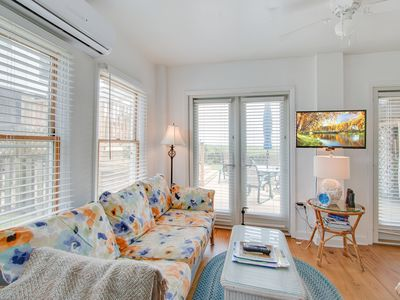 Photo for Dog-friendly oceanfront first floor condo w/ WiFi, full kitchen, and large deck!