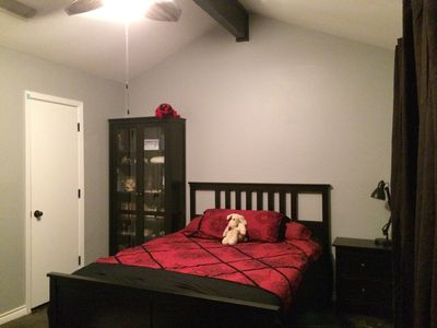 Master Bedroom with attached bath, large window to backyard, and ceiling fan.