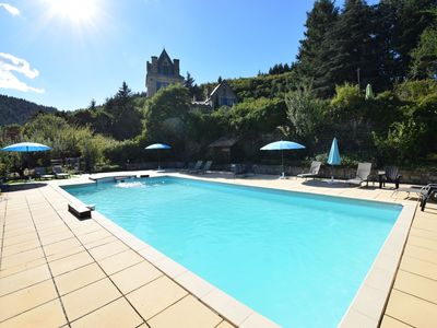 Photo for Apartment in 17-century castle with park and pool in the Ardèche region
