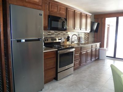 Full size stove/oven, stainless refrigerator, full size microwave