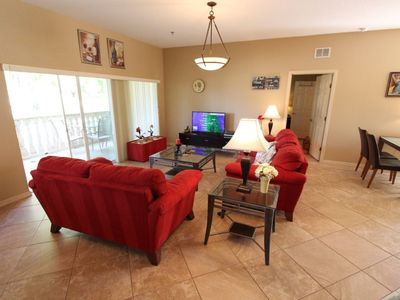 Photo for 2 bedroom, 2 bath with large patio view of the 18th green.