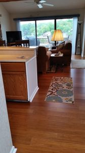 View walking into condo with new hardwood floors  - 2017