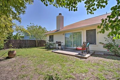 Enjoy the perks of a private backyard with a patio and gas grill.