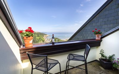 Photo for Cliff top apartment,indoor heated pool, stunning sea views, 2 mins walk to beach