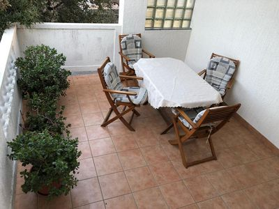 Photo for One bedroom apartment with terrace and sea view Barbat (Rab) (A-16723-b)