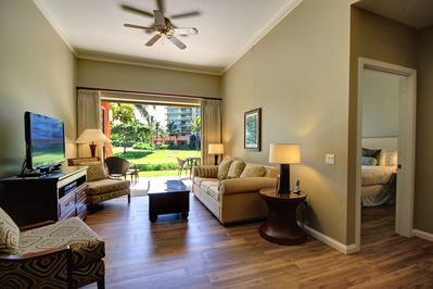 """living area with new beautiful wood tile flooring. Now features a 65"""" smart tv"""