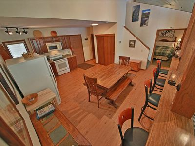 Photo for Inviting ski-in/ski out condo with private indoor hot tub and roomy loft, sleeps 8