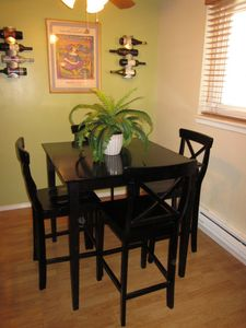 Dining room set for four with 2 additional bench stools for extra people.