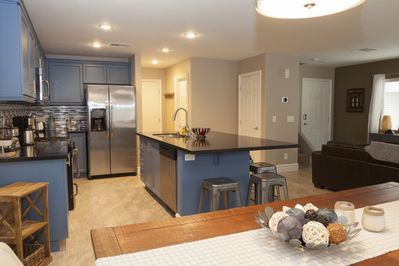 Gourmet kitchen, granite counters, stainless appliances, fully stocked