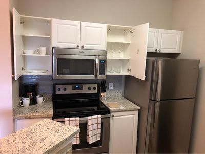 Kitchen Features Ample Storage and Granite Countertops