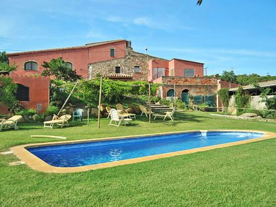 Photo for This 8-bedroom villa for up to 17 guests is located in Calonge and has a private swimming pool and W