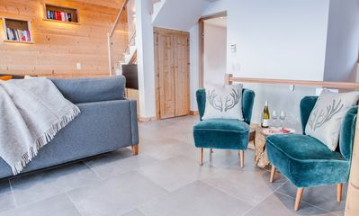 Photo for Stylish, central located chalet with hot tub + ensuite rooms. A Perfect Getaway!