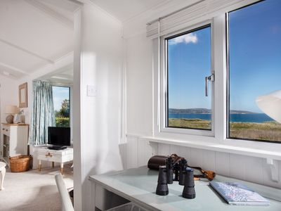 Photo for An idyllic beach house just a few steps away from the beach with panoramic views