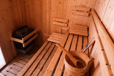 The Finnish sauna easily fits  6 people and has direct access to the fireplace