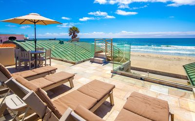 Photo for Surf Rider Condo with Private Rooftop Deck!