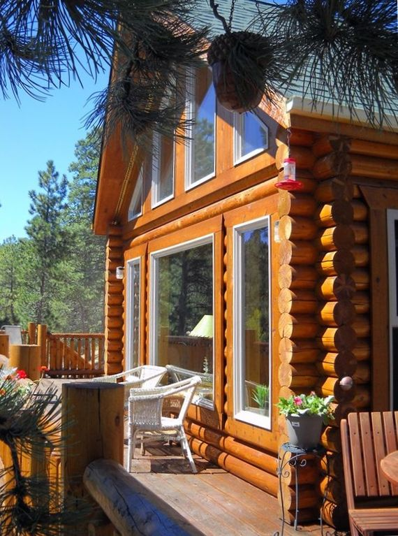 Sunny Deck Of Woodland Park Log Cabin Home