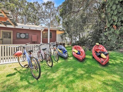 There are 5 bikes and the kayaks , a table tennis table for guests to use