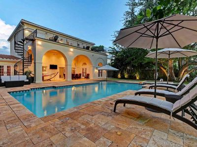 Photo for Luxury canal-front home with dock, pool & elevated deck - blocks to beach!